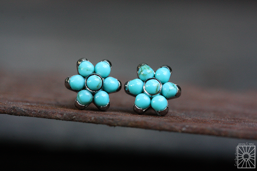 Titanium threaded flowers from Anatometal, featuring synthetic Turquoise.
