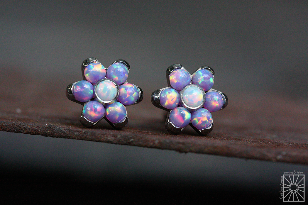 Titanium threaded flowers from Anatometal, featuring synthetic Lavender and White Opals.