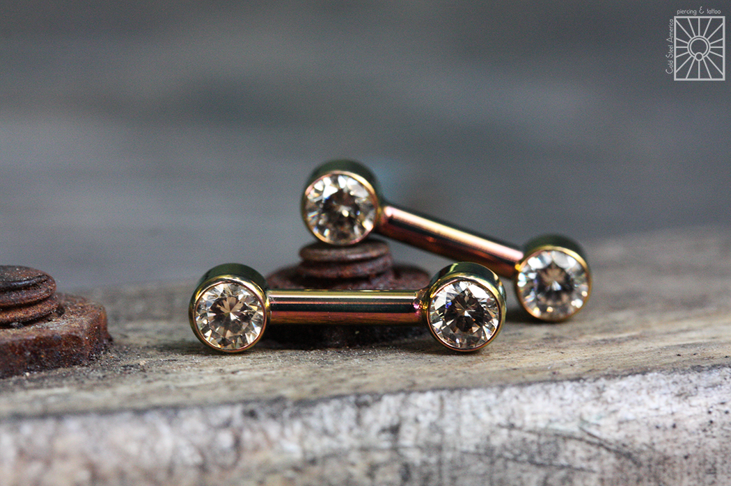 """Custom titanium forward-facing gem barbells with Champagne cz's, anodized """"Bronze"""" from Anatometal."""