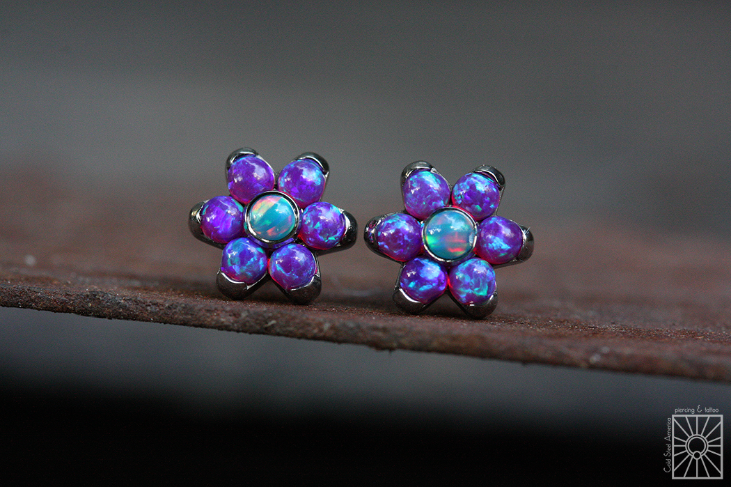 Titanium threaded flowers from Anatometal, featuring synthetic Purple and Teal Opals.