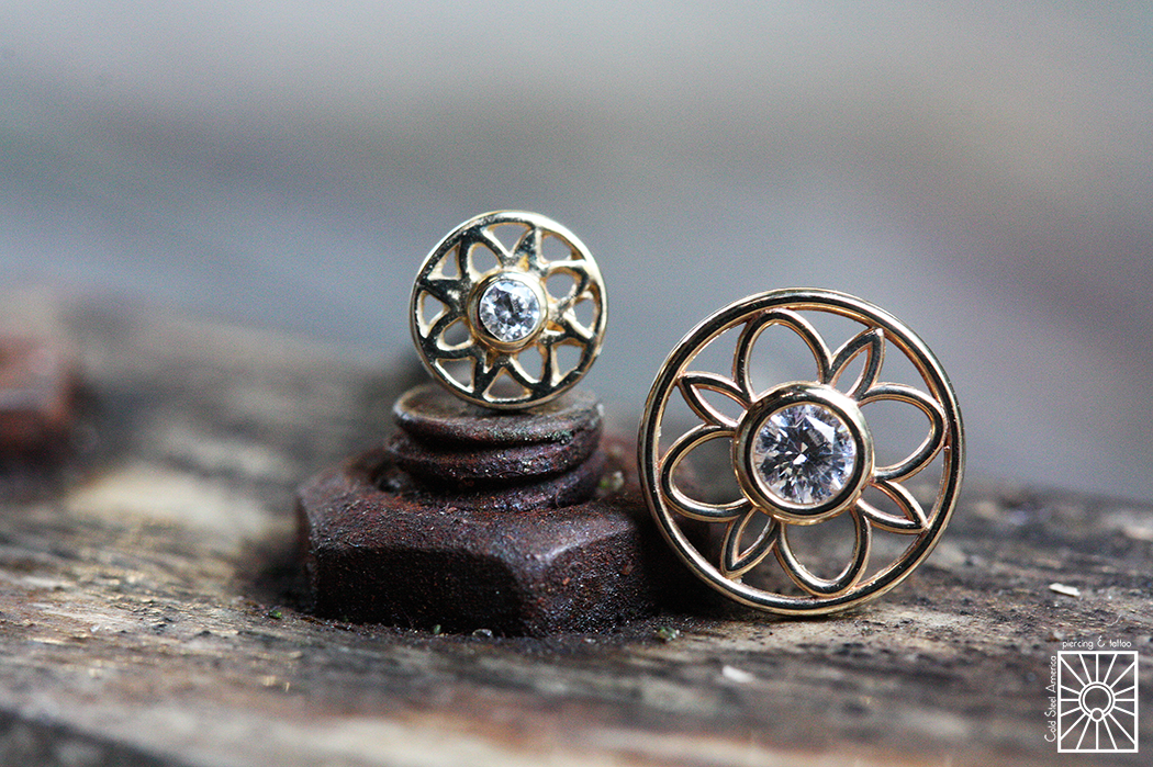 """14g solid Yellow Gold """"Paloma Flower"""" threaded ends featuring clear cz's from Body Vision Los Angeles."""
