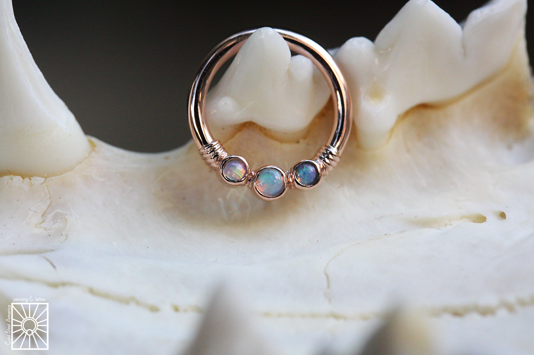 """This beautiful solid Rose Gold """"Faraway"""" continuous ring from Body Vision Los Angeles features three genuine AAA White Opals and is waiting for that special someone to come get fancy."""