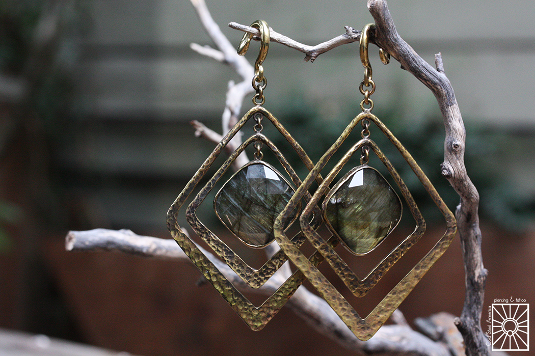 """Hammered Brass and faceted Labradorite """"Movement"""" weights from Diablo Organics."""
