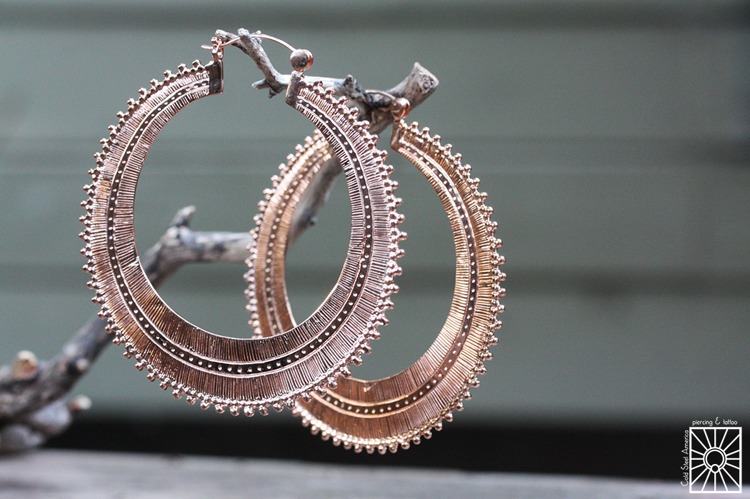 """Plated Rose Gold """"Afghan"""" hoops from Tawapa."""