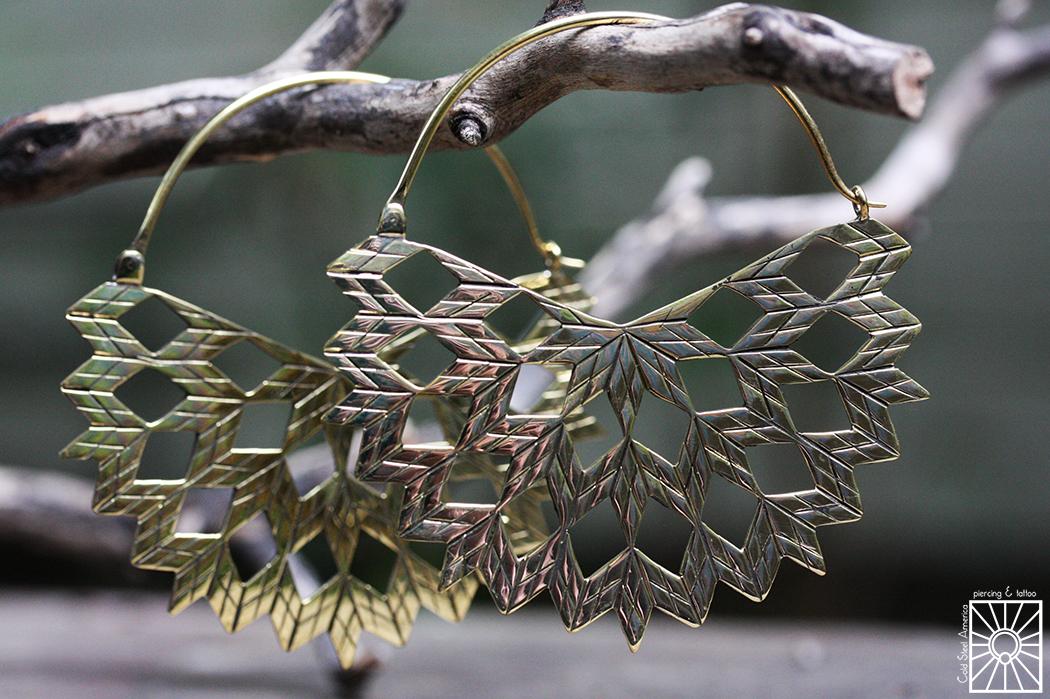"Hand-cut Brass ""Peacock"" hoops from, Diablo Organics."