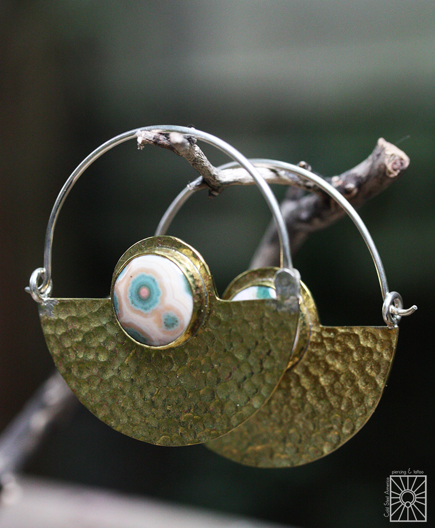 """Silver and distressed Brass """"Half Moon"""" hoops with inlayed Ocean Jasper stone from Diablo Organics."""