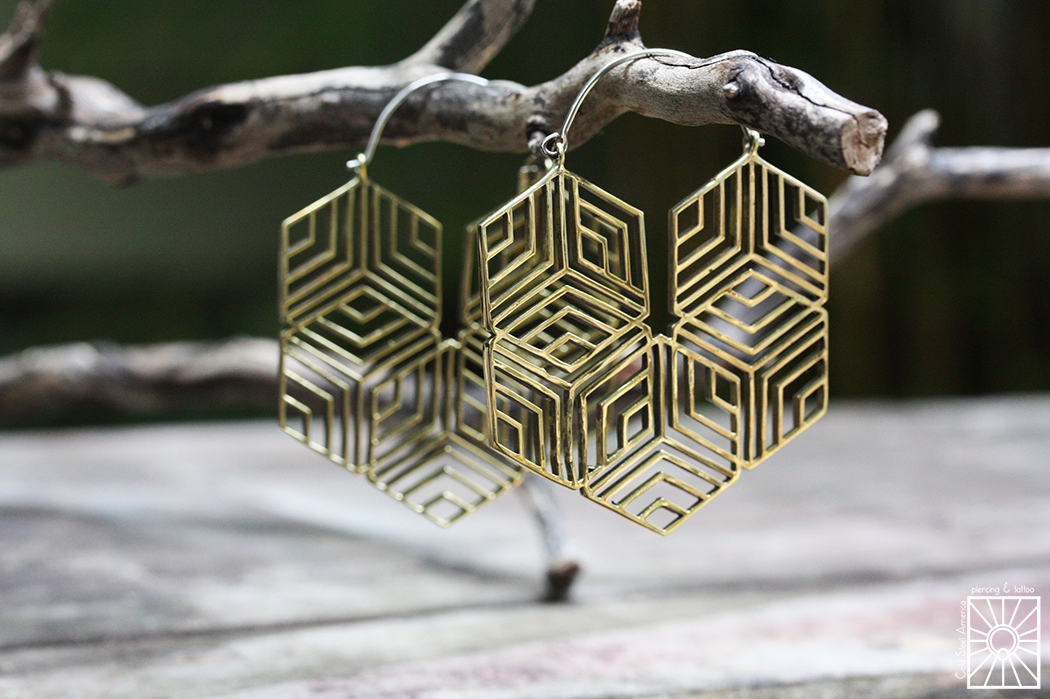 """Silver and Brass """"Hexagonal"""" hoops from Eleven44."""