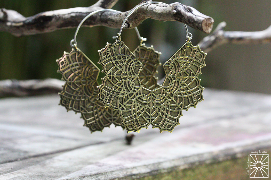 """Silver and Brass """"Lace"""" hoops from Eleven44."""