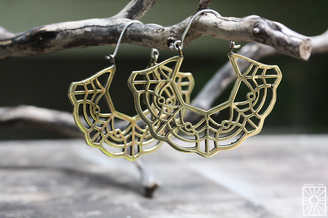 """Silver and Brass """"Marigold"""" hoops from Eleven44."""