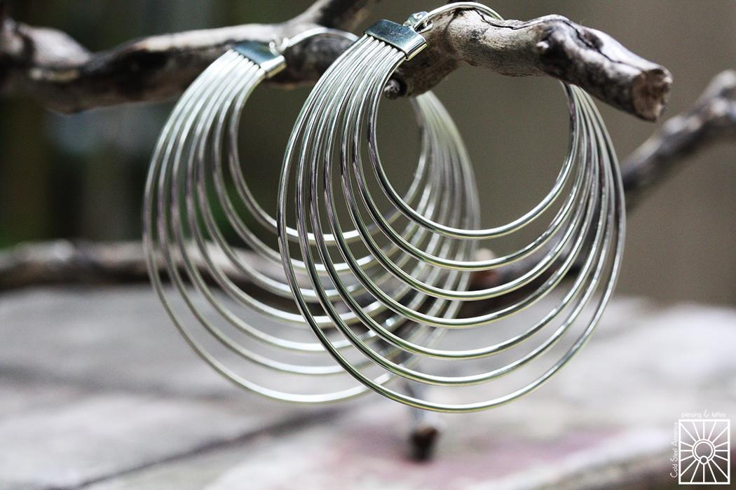 "Silver ""Saturn's Return"" hoops from Maya Jewelry."
