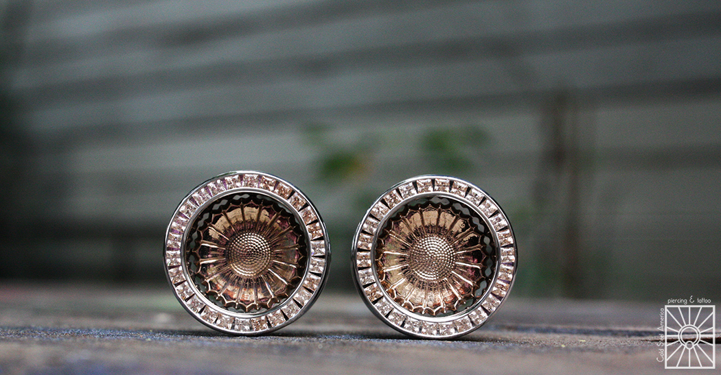 """Custom ordered these gorgeous eyelets from Anatometal, and as usual they haven't failed to please! 3/4"""" implant-grade steel with Bronze sunflower inserts and Princess-cut champagne cz's."""