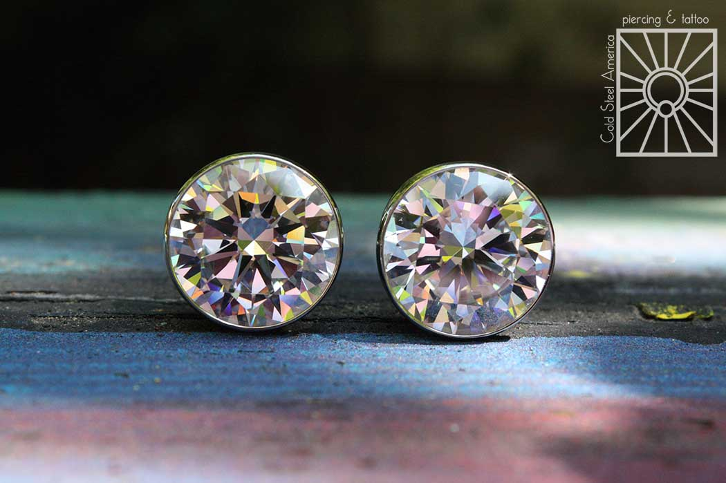 """5/8"""" (16mm) implant-grade steel and cubic zirconia plugs from Anatometal."""