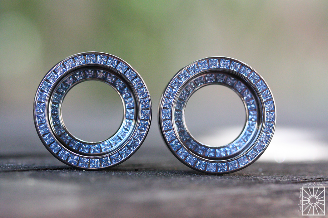 And our wonderful friends at Anatometal knock it out of the park yet again! These gorgeous Double Orbit eyelets are high polish titanium and feature princess-cut synthetic Aquamarine gems. You'll be able to see these beauties in the lobes of our most fancy staff member Devin in the very near future!