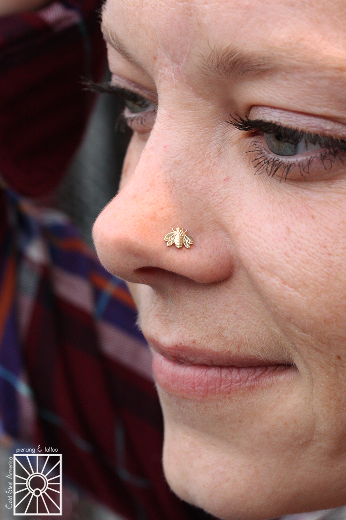 We did not pierce this lovely lady's nostril, but we did get to fancy it up with this solid Yellow Gold bumblebee threadless end from Body Gems!