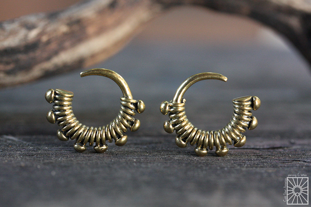 """We just picked up a set of these Brass """"Bound"""" hoops from the wonderful folks at Buddha Jewelry Organics, and at under an 1″ in diameter they sure do pack a lot of cute into a small package! Must be at least 12g to wear these little cuties."""