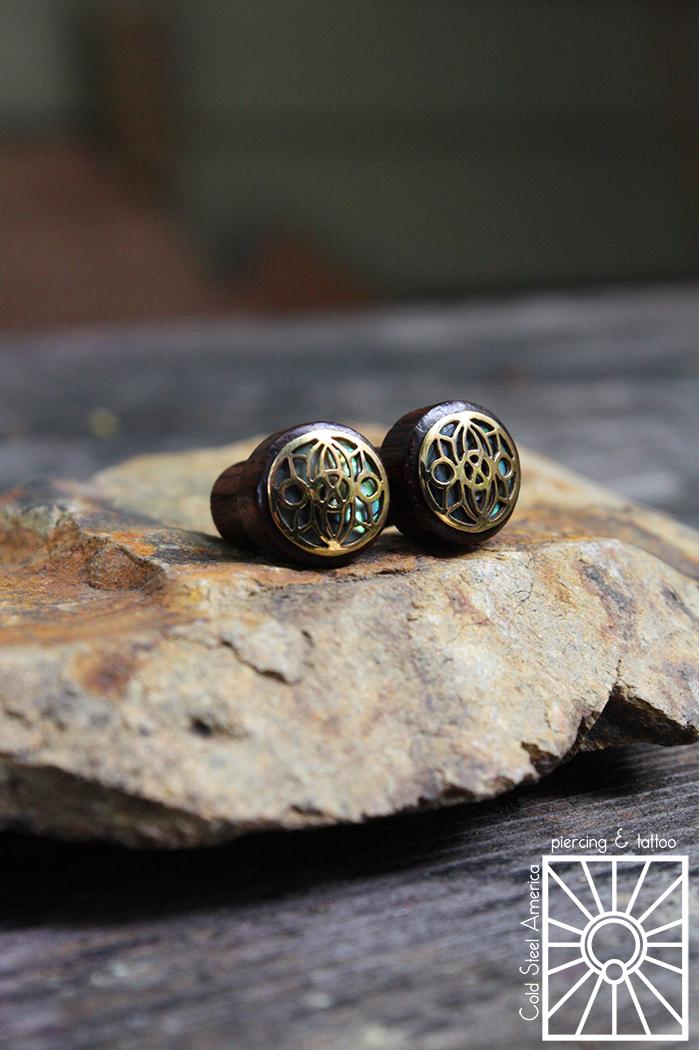 """2g (6mm) Ebony, brass, and Abalone shell """"Indah Full Moon"""" plugs from Buddha Jewelry Organics."""
