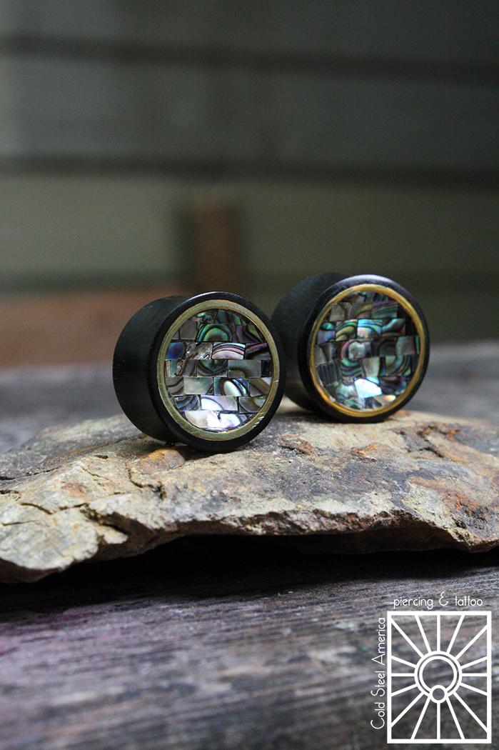 """7/8"""" (22mm) concave Ebony, brass and Abalone mosaic plugs from Buddha Jewelry Organics."""