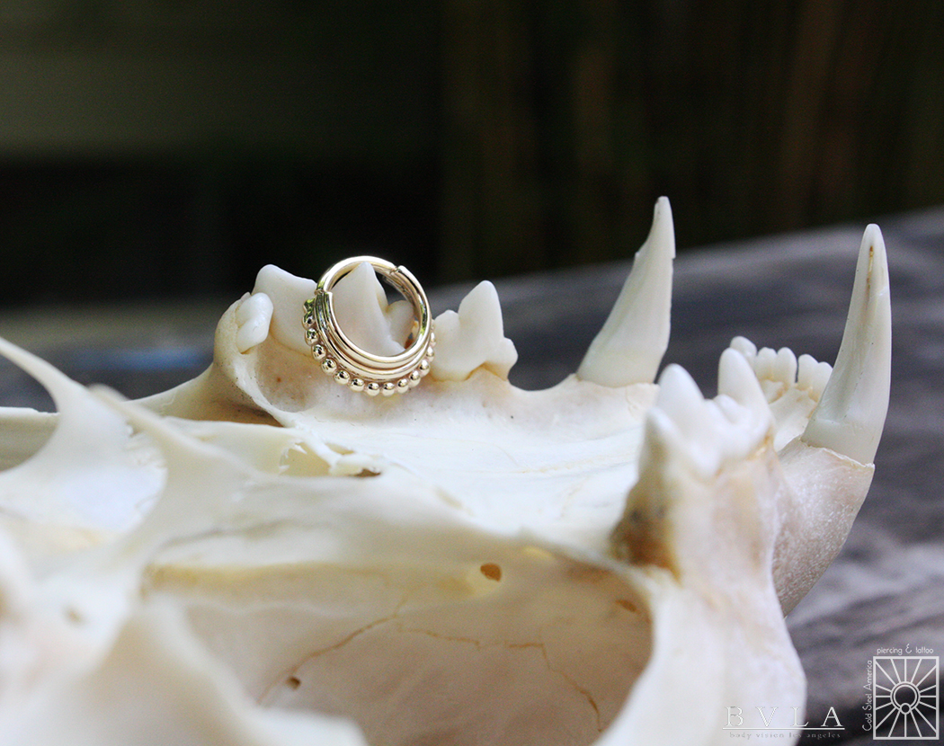 """Solid Yellow Gold """"Zara"""" hinged ring from Body Vision Los Angeles."""