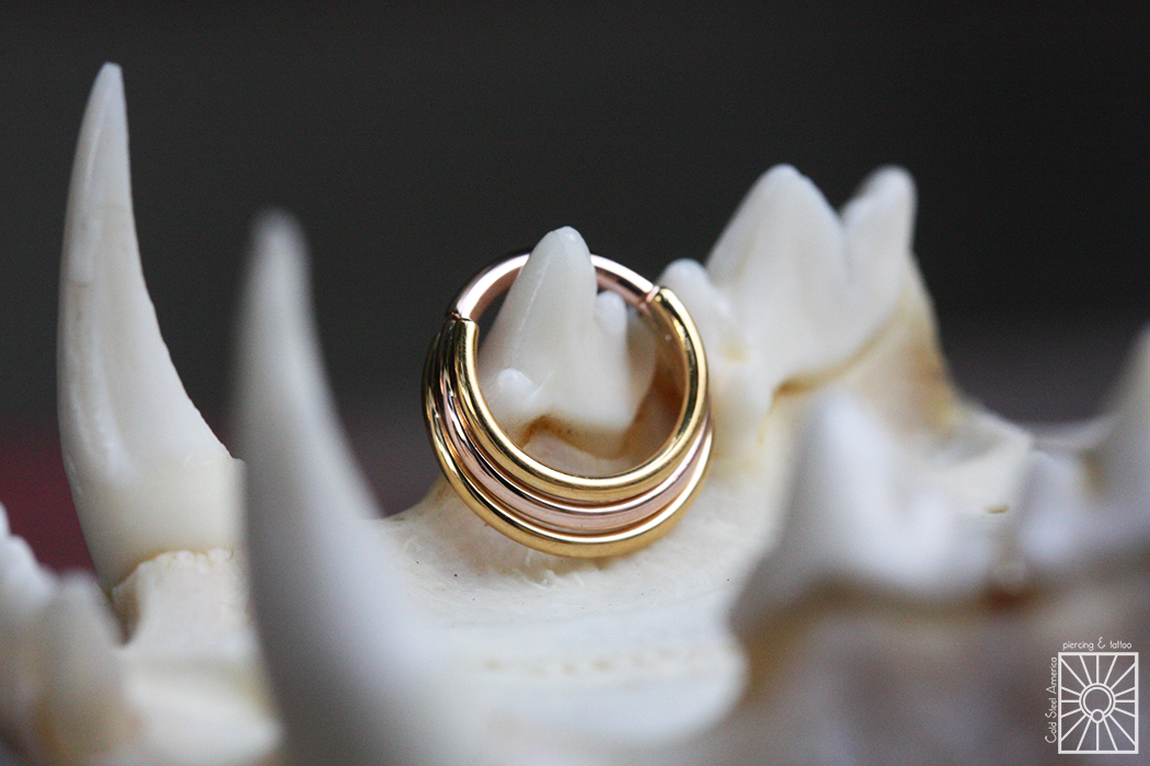 """16g """"Minimoody"""" hinged ring from Body Vision Los Angeles featuring solid 22k Yellow Gold outer rings and Rose Gold center ring."""