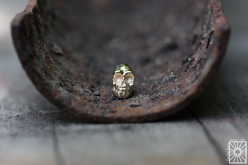 14g solid Yellow Gold skull threaded end.