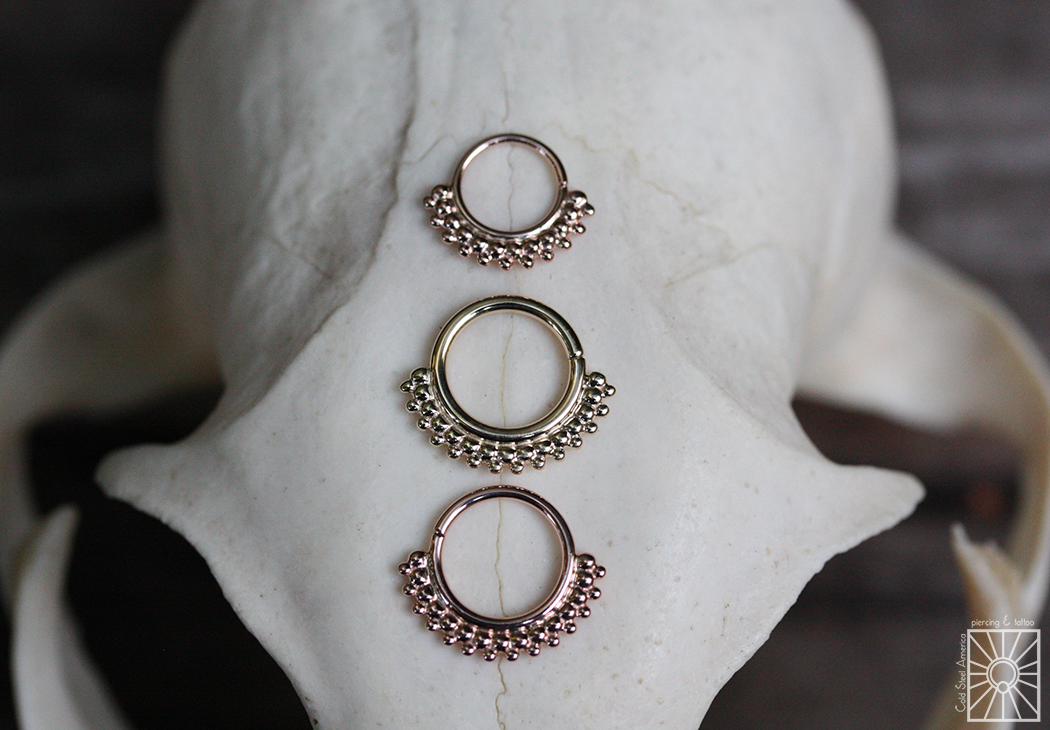 """Solid Yellow and Rose Gold """"Kolo"""" continuous rings."""