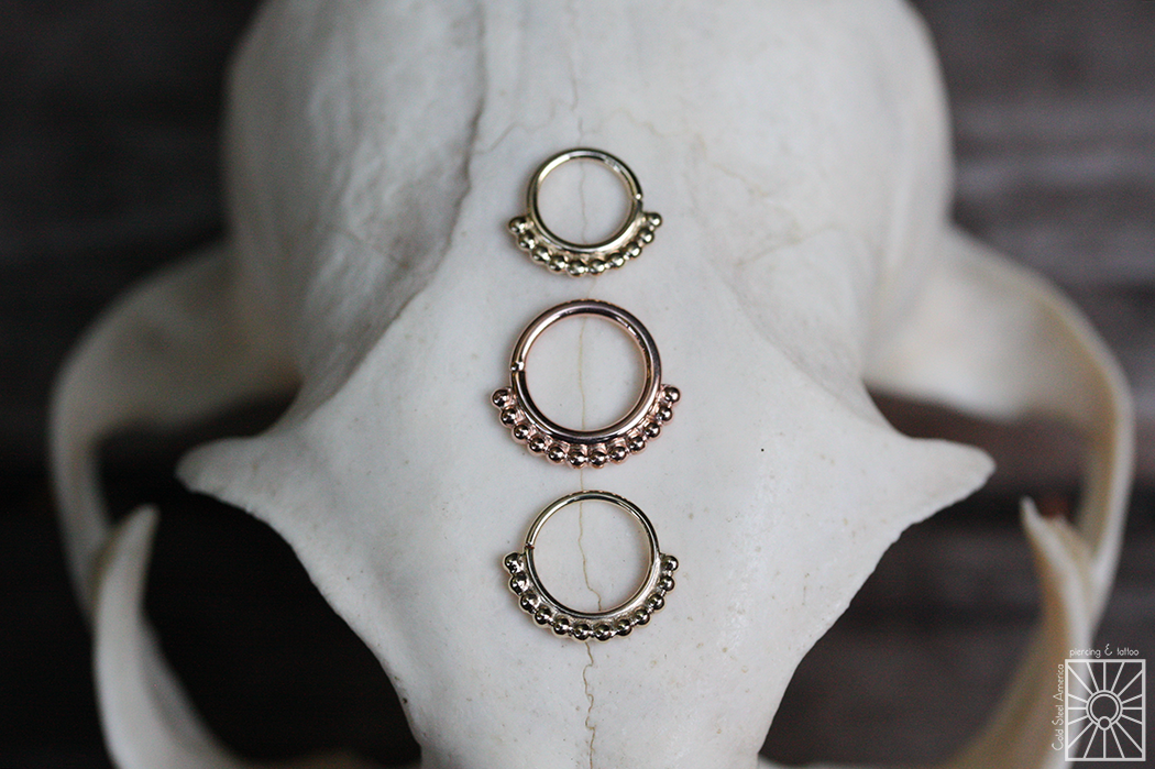 """Solid Yellow and Rose Gold """"Latchmi"""" continuous rings."""