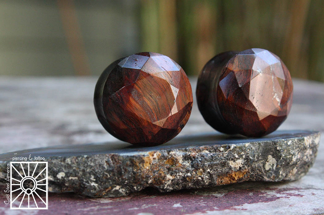 """7/8"""" faceted Red Tiger's Eye plugs from Tawapa."""
