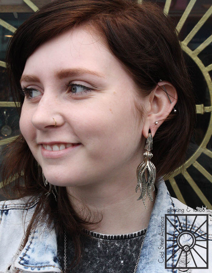 This fun young lady came in to the studio the other day, fell in love with these amazing silver squid weights from Tawapa and just had to have them! Don't they just look fantastic on her?!