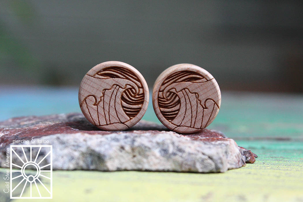 """1/2"""" (12-13mm) """"Breaking Waves"""" etched wood plugs from Omerica Organics."""