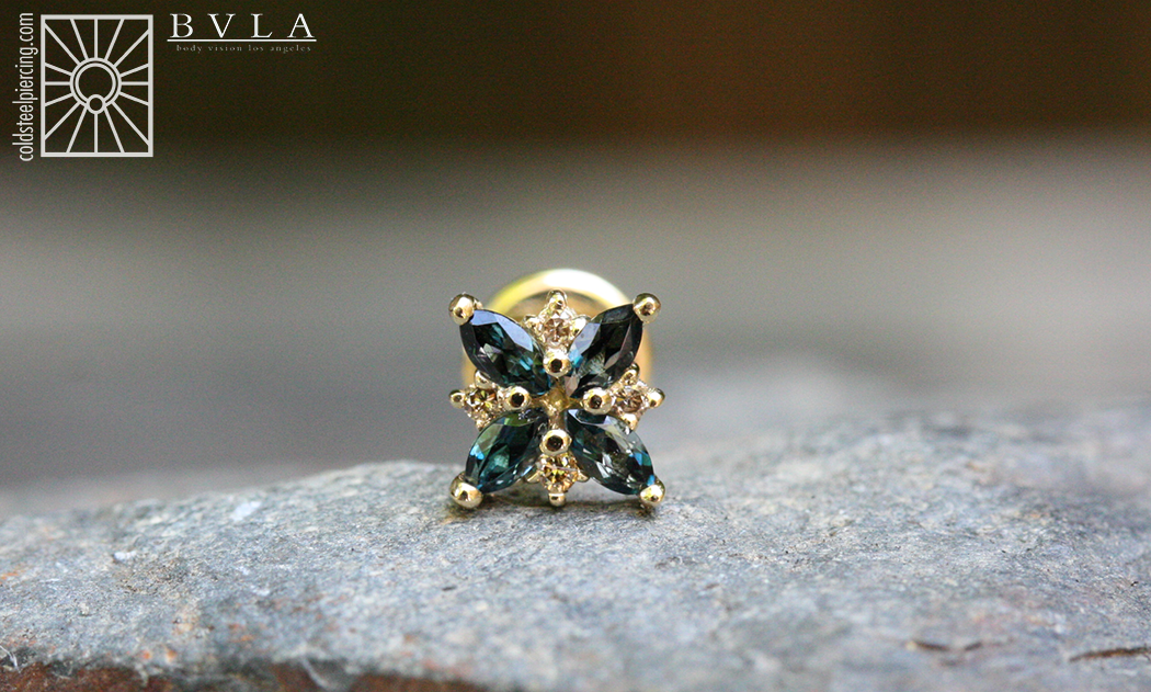 """This gorgeous piece arrived from Body Vision Los Angeles today for our own Becky Dill! """"Mini Pleades"""" featuring genuine AA London Blue Topaz and Grey Diamonds, and a 4mm Labradorite cabochon on the back, all in solid 18k Yellow Gold. This beauty is definitely going to make a fantastic addition to her collection!"""