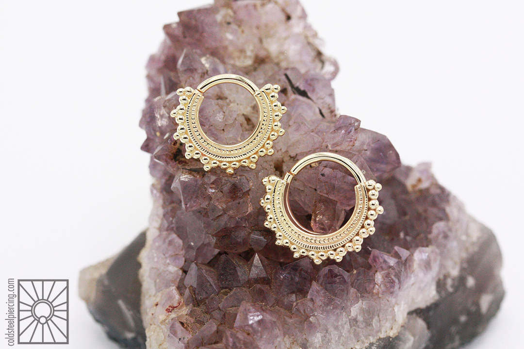 """14k Yellow Gold """"Afghan"""" continuous rings from Body Vision Los Angeles."""
