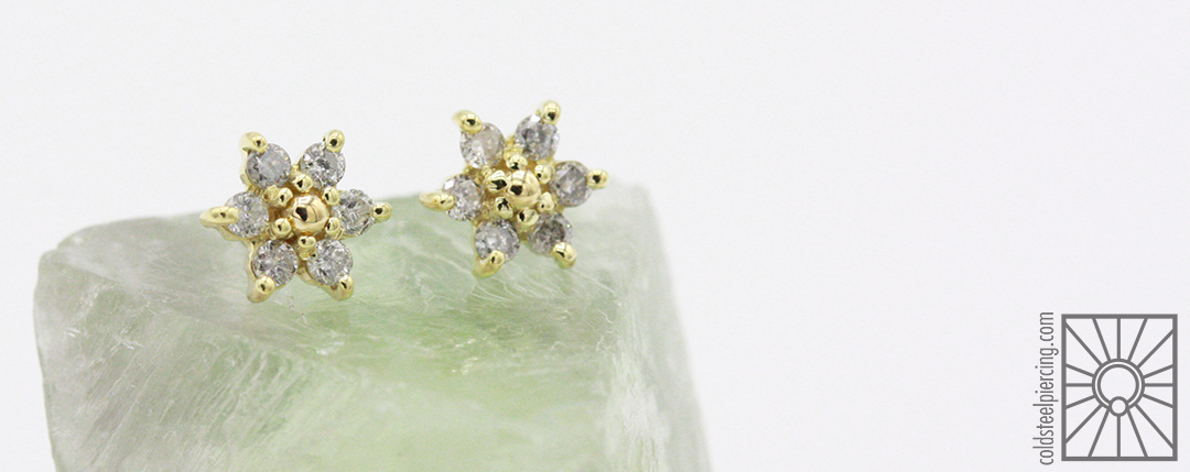 Maintaining her hold on the title of Fanciest Staff Member, our own Devin had these gorgeous 18k Yellow Gold and genuine Gray Diamond flower pieces made by our wonderful friends at Body Vision Los Angeles, can't wait to get photos of these beauties in action!