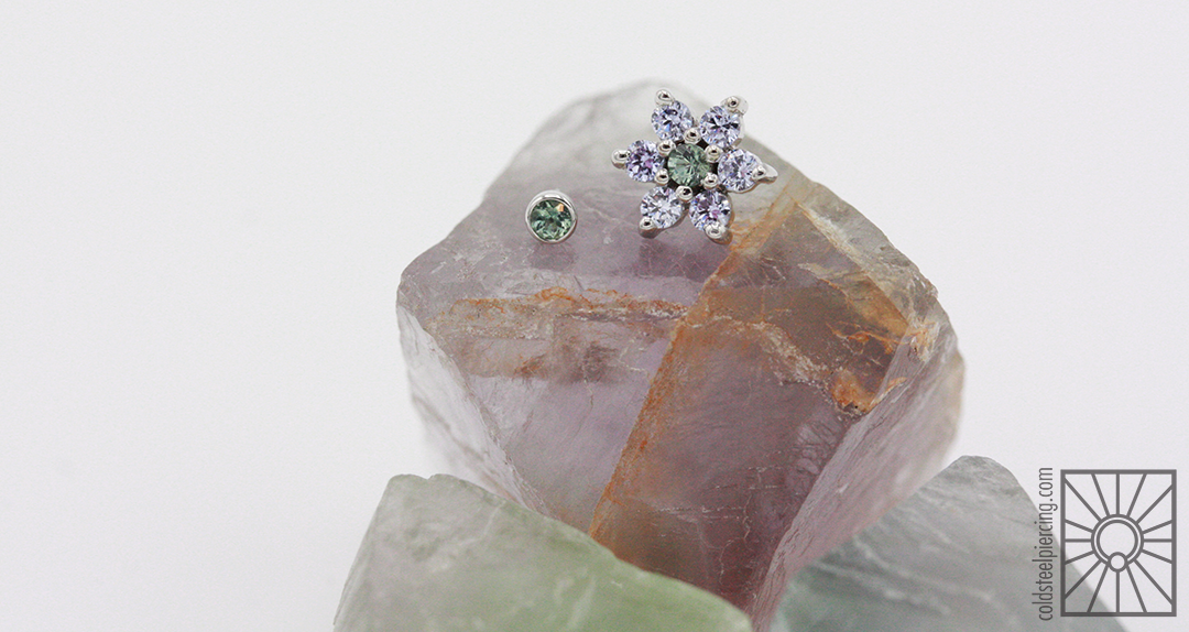 If this were a high school yearbook these two beauties would definitely get voted Cutest Couple!Solid White Gold with Lavender cz's and genuine Seafoam Tourmaline from those magicians at Body Vision Los ANgeles.