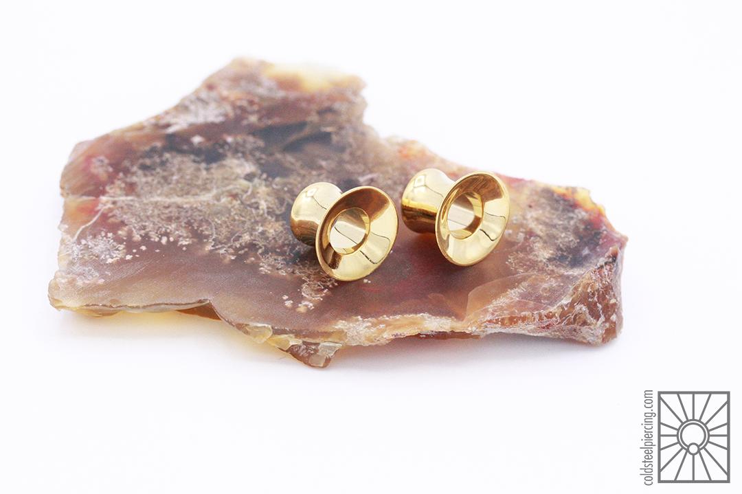 "Plated Yellow Gold ""Lao"" eyelets from Tawapa."
