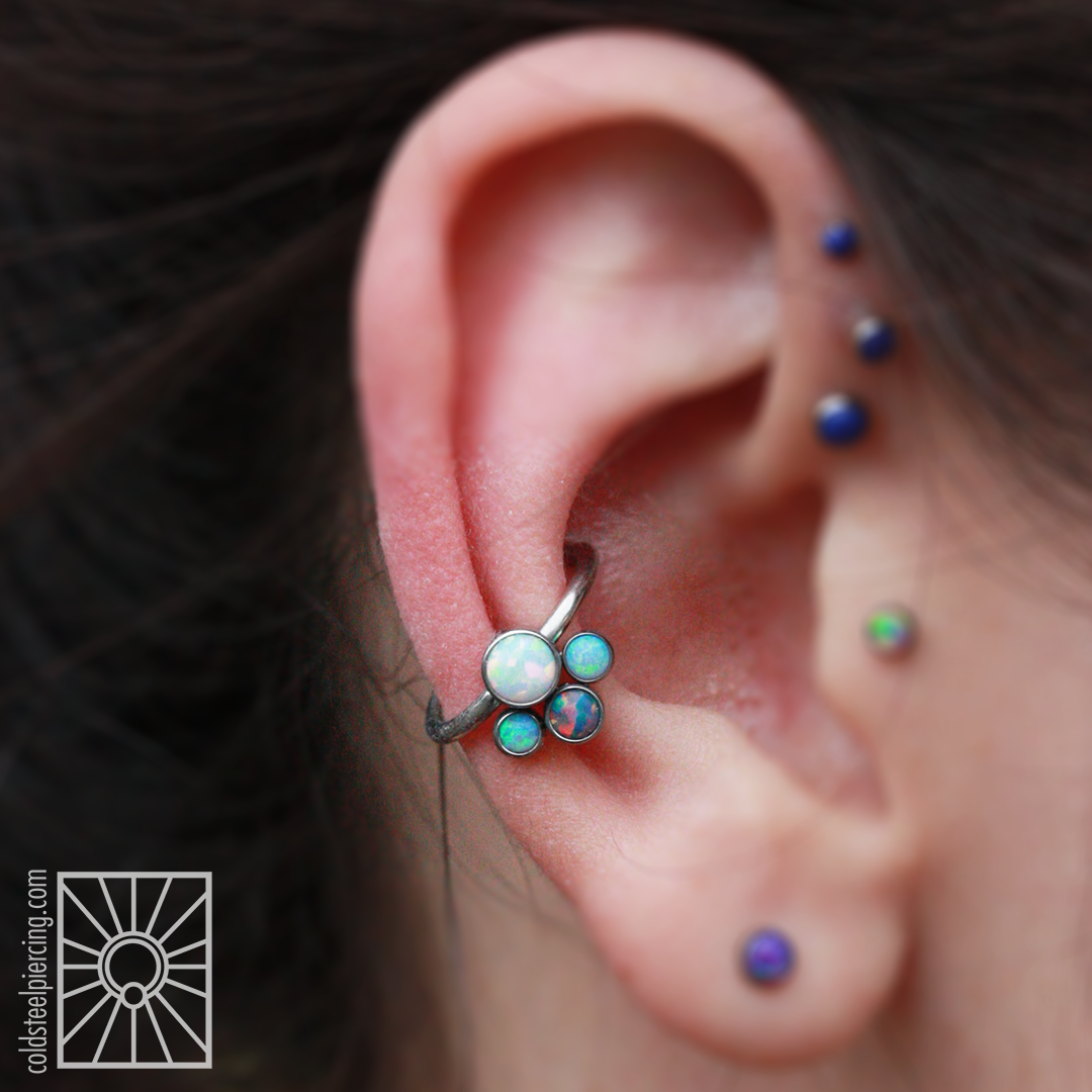 Super cute titanium 4-gem captive cluster we had custom made for this client by Anatometal.