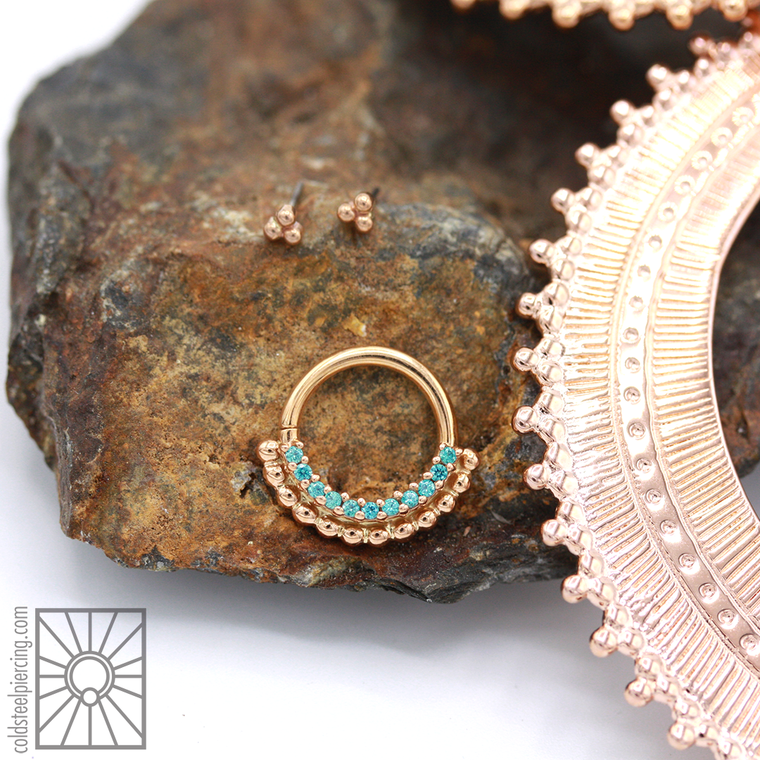 """Solid Rose Gold 3 bead threadless ends and Rose Gold and Mint Green cz """"Aria"""" continuous ring from Body Vision Los Angeles. Plated Rose Gold """"Afghan Hoops"""" from Tawapa."""