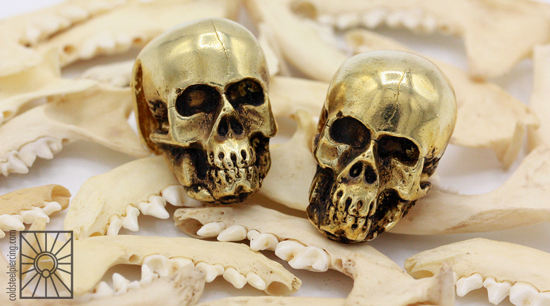 Brass skull weights from AKA Adornments.