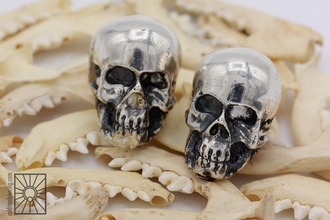 Silver skull weights from AKA Adornments.