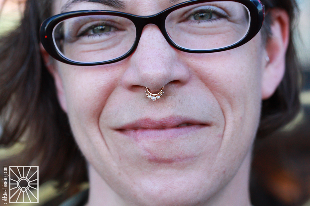 """We did not pierce this lovely woman's septum, but we did install this beautiful Rose Gold and genuine Pearl """"Barra"""" continuous ring from Body Vision Los Angeles!"""