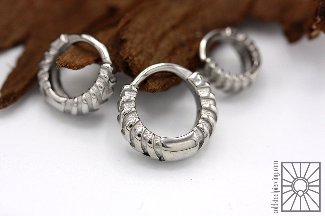 """316L steel """"Chevronelle"""" hinged rings from Tether Jewelry."""