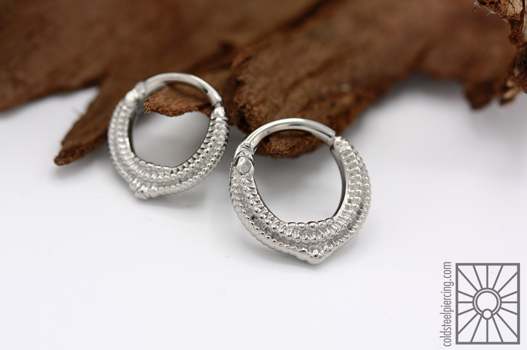 """316L steel """"Melange"""" hinged rings from Tether Jewelry."""
