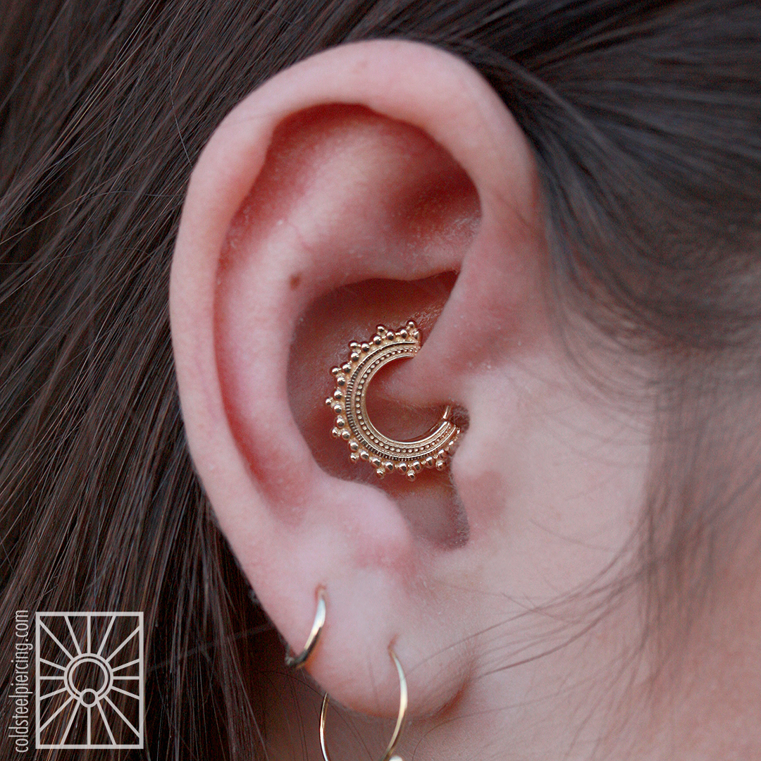 """We did not pierce this wonderful young lady's daith, but we did get to help her celebrate her birthday by installing this gorgeous yellow gold """"Afghan"""" hoop from Body Vision Los Angeles! What a fantastic choice, and a great way to really kick off your birthday right."""