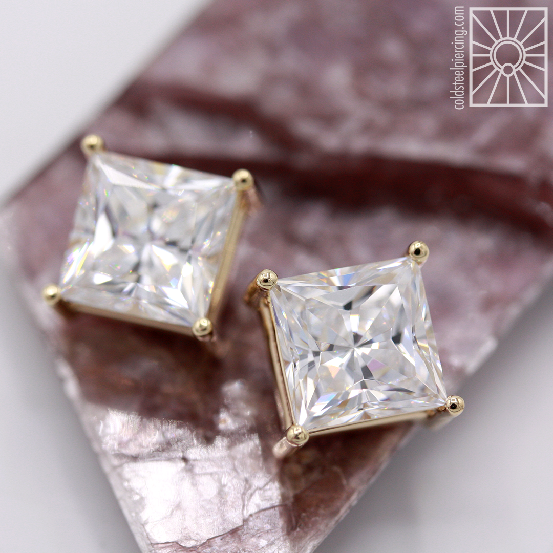 Kapow! One of our clients came in wanting something big and blingy for his earlobes, and we were happy to oblige! 8mm princess-cut cubic zirconia threaded ends in 14k yellow gold from Body Vision Los Angeles. Ready for some next level sparkle? Come see us!