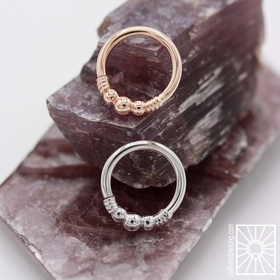 """16g 5/16"""" """"Myla"""" continuous rings in solid 14k Rose and White Gold from Body Vision Los Angeles."""