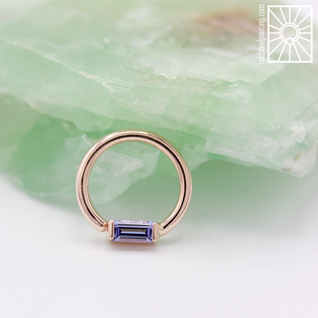 Meet one of our new favorite pieces, isn't it gorgeous?! Rose gold fixed gem ring with a baguette-cut genuine Tanzanite from Body Vision Los Angeles.This beauty is definitely a showstopper.