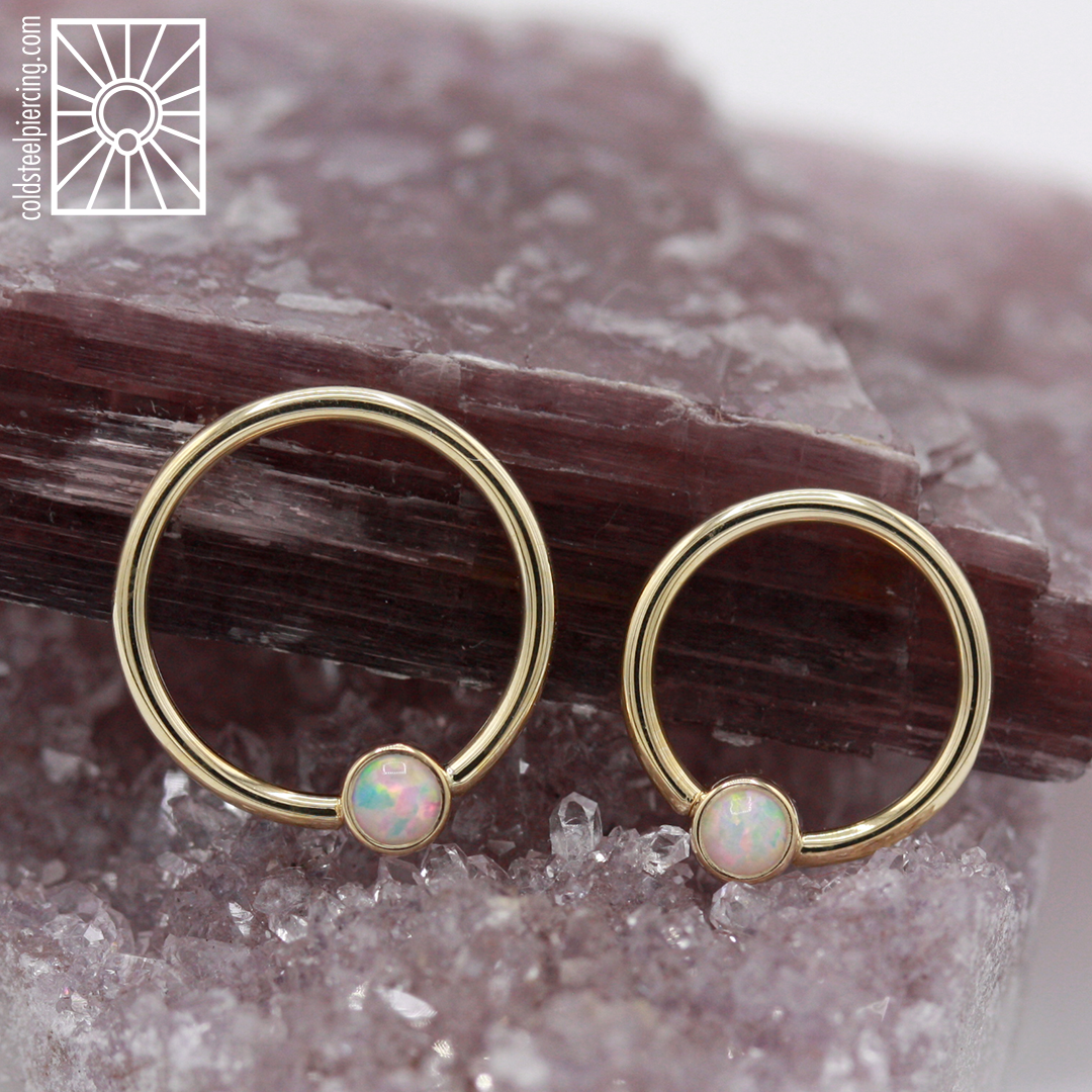 Gold and opal, always one of our favorite combinations! 14k gold fixed gem rings from Body Vision Los Angeles, these beauties are sure to go fast, drop in and get fancy.