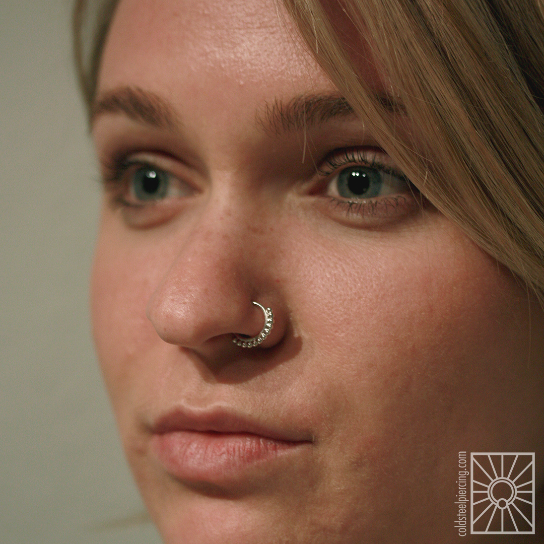 """Beautifully healed nostril piercing we did awhile ago, upgraded to this super cute White Gold """"Latchmi"""" continuous ring from Body Vision Los Angeles!"""
