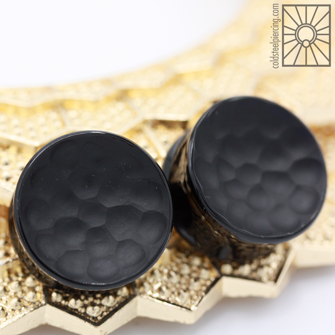 """Fantastic set of 1"""" double flare, double concave glass plugs with Martele texture from Gorilla Glass."""