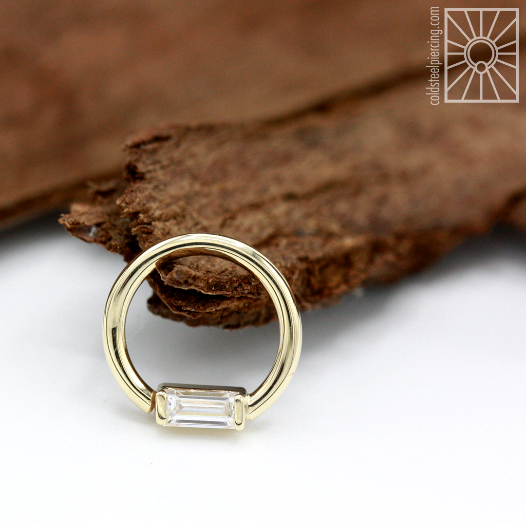 """16g 5/16"""" solid 14k Yellow Gold continuous ring with baguette-cut clear cubic zirconia from Body Vision Los Angeles."""