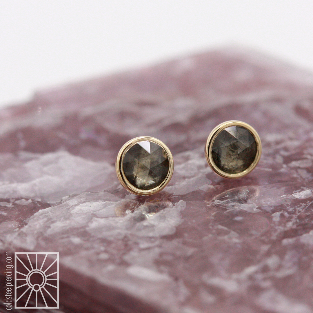 Our new obsession! Solid 14k Yellow Gold rose-cut genuine Gray Sapphire threadless ends from Body Vision Los Angeles.
